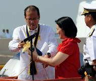 Philippine President Benigno Aquino (L) and his sister Balsy Aquino-Cruz (C) lead in the commissioning ceremonies of the newly-acquired Hamilton-class cutter Gregorio del Pilar in Manila