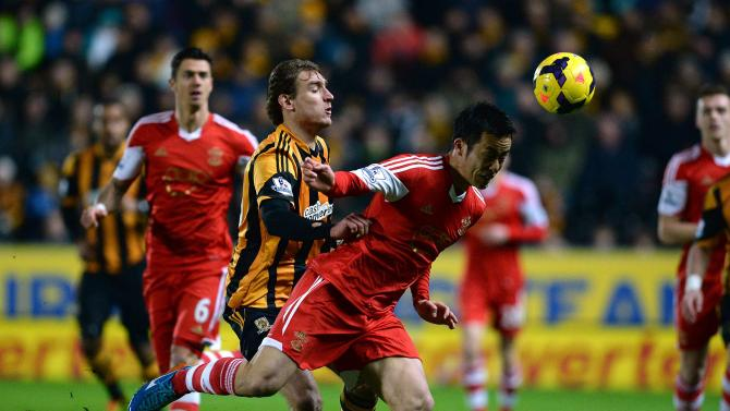 Southampton's Maya Yoshida challenges Hull City's Jelavic during their English Premier League soccer match at the KC Stadium in Hull