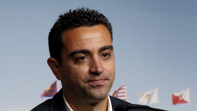 Barcelona's Xavi Hernandez announces the pregnancy of his wife Nuria Cunillera during his farewell event at Auditori 1899 in Nou Camp stadium Barcelona