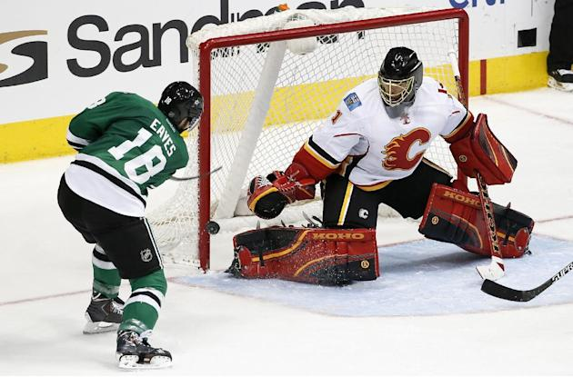Flames use big 2nd period to beat host Stars 5-3