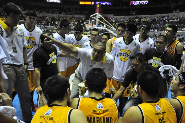 UST coach Pido Jarencio gives instructions during a timeout. (NPPA Images)