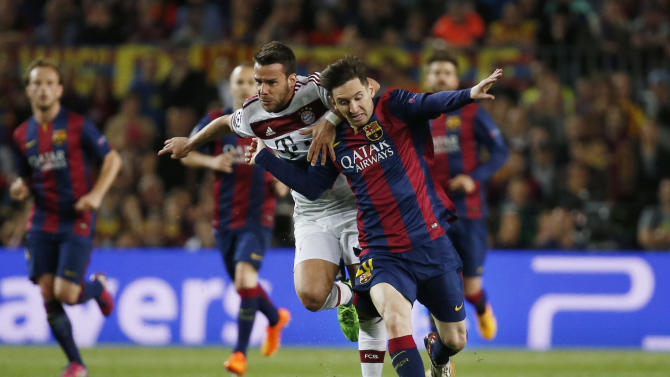 Football: Barcelona's Lionel Messi in action with Bayern Munich's Juan Bernat
