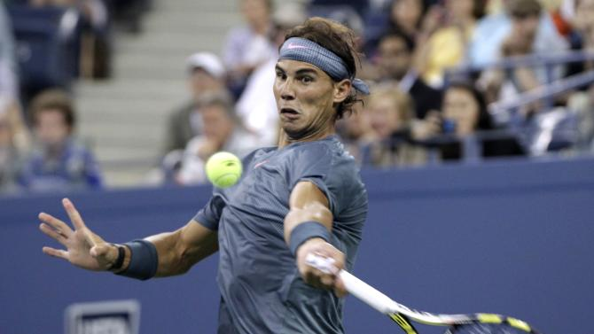 Rafael Nadal of Spain returns a volley to Rogerio Dutra Silva of Brazil at the U.S. Open tennis championships in New York