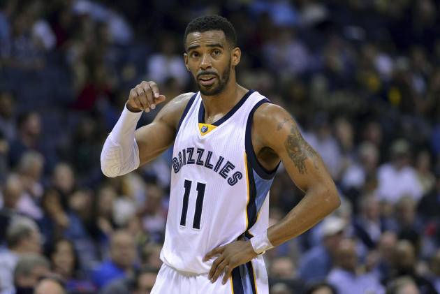 FILE - In this Monday, March 30, 2015 file photo, Memphis Grizzlies guard Mike Conley (11) plays in the first half of an NBA basketball game against the Sacramento Kings in Memphis, Tenn. Mike Conley