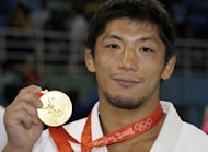 Japan's retired double Olympic judo gold medallist Masato Uchishiba, pictured here in 2008, on Wednesday denied raping one of his teenage students in a hotel room, as his trial opened in Tokyo