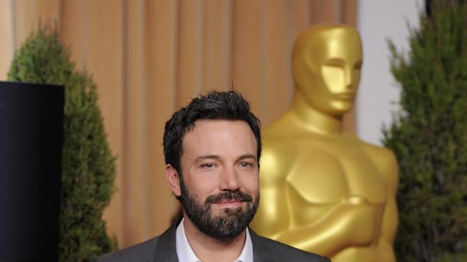 """FILE - In this Monday, Feb. 4, 2013 photo, Ben Affleck, nominated for best picture for """"Argo,"""" arrives at the 85th Academy Awards Nominees Luncheon at the Beverly Hilton Hotel in Beverly Hills, Calif. Like almost every awards season, earlier honors have established clear favorites for the top prizes at Sunday's Oscars, where Ben Affleck's CIA thriller """"Argo"""" is expected to take home the best-picture trophy. The 85th Academy Awards are in Los Angeles on Feb. 24. (Photo by Chris Pizzello/Invision/AP, File)"""