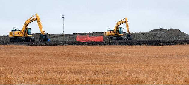 FILE - This Oct. 11, 2013 file photo shows cleanup at the site of an oil pipeline leak and spill near Tioga, N.D. The state Health Department says cleanup of a pipeline rupture that caused more than 2