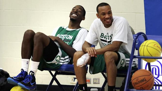 Boston Celtics guards Jordan Crawford, left, and Avery Bradley laugh during a break during their NBA basketball training camp at Salve Regina University, Wednesday, Oct. 2, 2013, in Newport, R.I