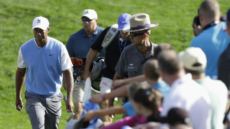 Tiger Woods walks to the 16th tee during a practice round for the PGA Championship golf tournament at Oak Hill Country Club, Tuesday, Aug. 6, 2013, in Pittsford, N.Y. (AP Photo/Charlie Neibergall)