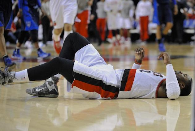 Portland Trail Blazers' Wesley Matthews after injuring his left achilles against the Dallas Mavericks during the second half of an NBA basketball game in Portland, Ore., Thursday, March 5, 2015. T