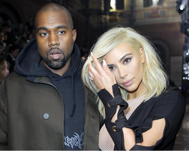 Kanye West and Kim Kardashian arrive for Lanvin's ready-to-wear Fall-Winter 2015/2016 fashion collection, part of the Paris Fashion Week, Thursday March 5, 2015 in Paris, France. (AP Photo/Jacques