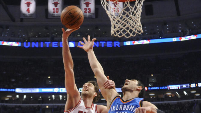 Chicago Bulls forward Pau Gasol (16) shoots over Oklahoma City Thunder center Enes Kanter (34) during the first half of an NBA basketball game, Thursday, March 5, 2015 in Chicago.  (AP Photo/David Banks)