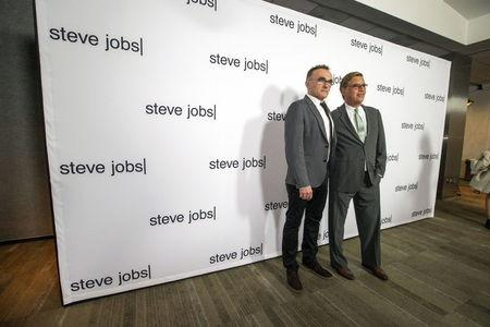 """Director of the movie Boyle poses with writer Sorkin at an industry screening of """"Steve Jobs"""" at the Academy of Motion Picture Arts and Sciences in Beverly Hills"""