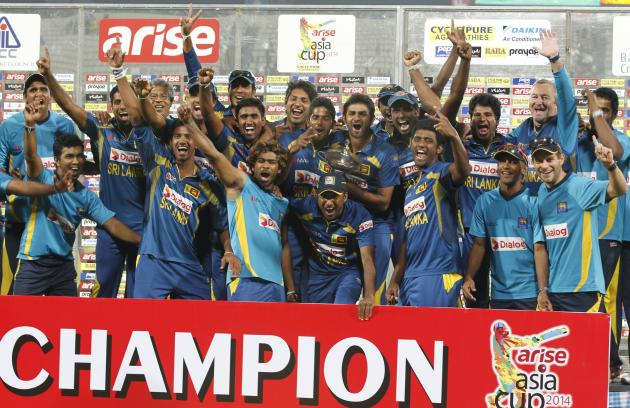 Sri Lanka's fielders pose with the winning trophy after Sri Lanka won the 2014 Asia Cup final against Pakistan in Dhaka.