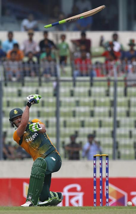 The bat slip away, as South Africa's captain Faf du Plessis plays a shot during their first Twenty20 international cricket match against Bangladesh in Dhaka, Bangladesh, Sunday, July 5, 2015. (AP Phot