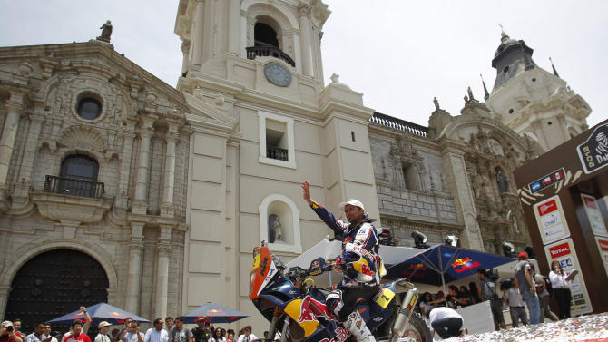 Cyril Despres, of France, rides away from the winner's podium on his KTM after attending the 2012 Argentina-Chile-Peru Dakar Rally podium ceremony in Lima, Peru, Sunday Jan. 15, 2012. Despres won his fourth Dakar Rally title on Sunday, completing the final stage two weeks after the race began in Argentina. (AP Photo/Martin Mejia)