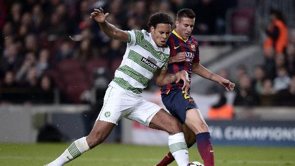 FC Barcelona's Cristian Tello, right, duels for the ball against Celtic's Virgil Van Djik  during a Champions League soccer match group H at the Camp Nou in Barcelona, Spain, Wednesday, Dec. 11, 2013