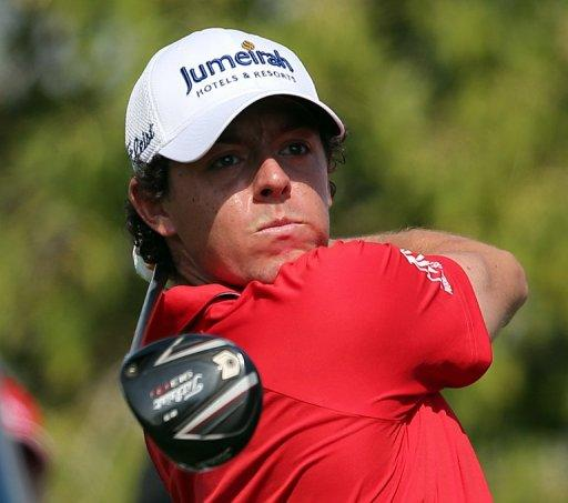 Rory McIlroy plays a shot in the DP World Tour Championship in Dubai on Sunday. McIlroy responded in magnificent fashion to Justin Rose's course record round of 10-under par 62 by making five birdies in his last five holes to win the DP World Tour Championship in Dubai on Sunday