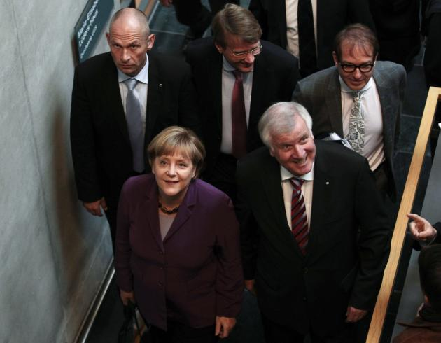 German Chancellor and leader of CDU party Merkel and leader of Christian Social Union party Seehofer arrive for preliminary coalition talks between Germany's conservative parties and the environmental