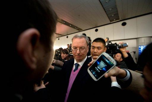 Google chairman Eric Schmidt (C) is seen surrounded by the media after arriving in Beijing from North Korean capital Pyongyang, on January 10, 2013. Schmidt told North Korean officials their country would never develop unless it embraced Internet freedom, he said as he returned from his trip.