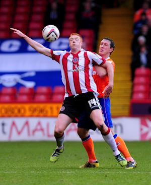 Dave Kitson, left, jumped off his sick bed to help Sheffield United defeat Preston