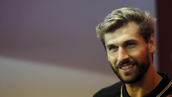 Sevilla's new signed player Llorente smiles during his presentation in the Andalusian capital of Seville, southern Spain