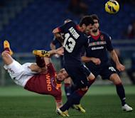 AS Roma's Pablo Daniel Osvaldo (L) fights for the ball with Cagliari's Luca Rossettini during their Italian Serie A match in Rome's Olympic Stadium, on Febuary 1, 2013. Roma host Juventus next, on Saturday
