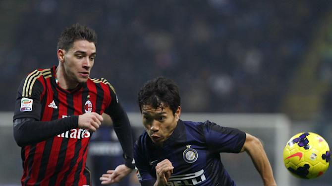 Inter Milan defender Yuto Nagatomo, right, and AC Milan's Mattia Di Sciglio go for the ball during a Serie A soccer match, at the San Siro stadium in Milan, Italy, Sunday, Dec. 22, 2013. A late goal from Rodrigo Palacio gave Inter Milan a 1-0 win over city rival AC Milan in an entertaining derby match in Serie A on Sunday. Palacio struck four minutes from time to send three quarters of San Siro into a frenzy