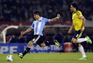 Argentina's Sergio Aguero lines up a shot in front of Colombia's Mario Yepes during their FIFA World Cup Brazil 2014 qualifying match at Monumental stadium in Buenos Aires on June 7, 2013. The match ended 0-0
