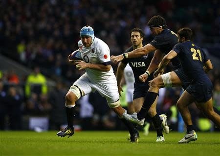 England's Ben Morgan runs in to score a try against Argentina during their international rugby union match at Twickenham in London