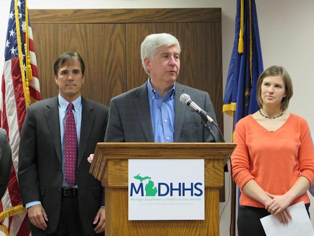 Gov. Rick Snyder marks the merger of two of Michigan's largest state agencies into the Department of Health and Human Services on Tuesday, April 14, 2015, at the department's Ingham County office in L