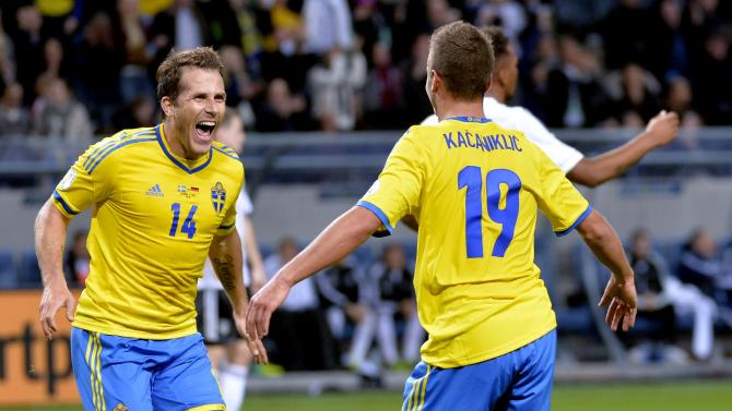 Sweden's Alexander Kacaniklic, right, celebrates with teammate Tobias Hysen, left, after scoring his team's second goal during the 2014 World Cup group C qualifying soccer match between Sweden and Germany at Friends Arena in Stockholm, Sweden, on Tuesday Oct. 15, 2013