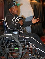 Timothy Bradley addresses the media during the post-fight press conference in a wheelchair after defeating Manny Pacquiao by split decision at MGM Grand Garden Arena in Las Vegas, Nevada