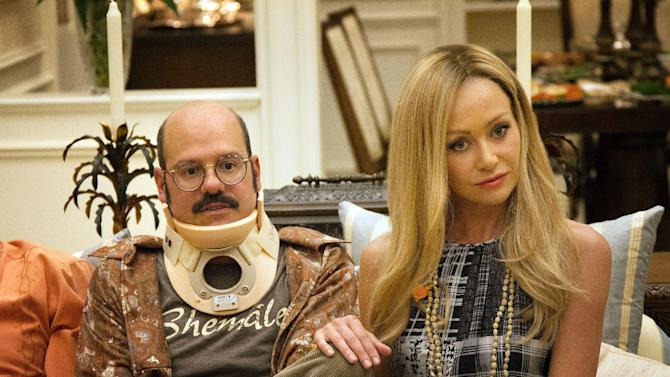 """This undated publicity photo released by Netflix shows David Cross, left, and Portia de Rossi in a scene from """"Arrested Development,"""" premiering May 26, 2013 on Netflix. The sitcom, also starring Jason Bateman and Will Arnett, was canceled by Fox in 2006 after three seasons. (AP Photo/Netflix, Sam Urdank)"""