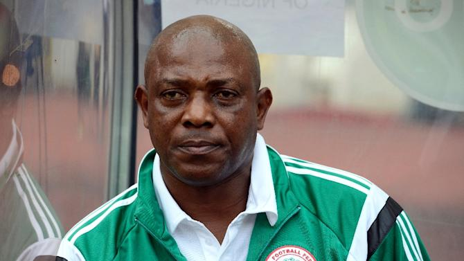 Nigeria's coach Stephen Keshi watches a match between Nigeria and Sudan in Abuja on October 15, 2014