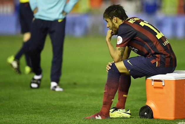 Barcelona's Neymar sits with his left boot off at the end of the Spanish Copa del Rey (King's Cup) final against Real Madrid at the Mestalla stadium in Valencia on April 16, 2014