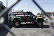 FILE – This June 22, 2016, file photo shows a vehicle sitting in the impound lot of The Port Authority of New York & New Jersey's Port Authority Police Department, a day after three Pennsylvania residents in the vehicle that carried a cache of weapons were stopped before entering the Holland Tunnel in Jersey City, N.J. New Jersey Superior Court Judge Mitzy Galis-Menendez announced her decision Monday, Feb. 13, 2017, not to throw out evidence against the three Pennsylvania residents, who said they were on a mission to rescue a teenager from a New York heroin den when they were stopped in the vehicle that contained five handguns, a shotgun and a semi-automatic rifle. (AP Photo/Julio Cortez, File)