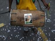 An image of India's Hindu nationalist Narendra Modi is pasted on a drum during celebrations before Modi was crowned as the prime ministerial candidate for India's main opposition Bharatiya Janata Party (BJP), outside its party headquarters in New Delhi September 13, 2013. REUTERS/Ahmad Masood