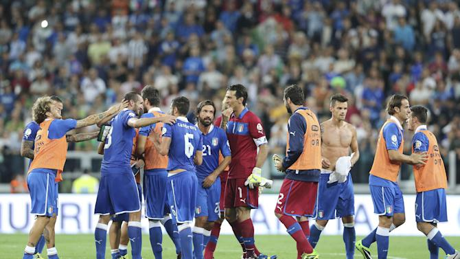 Italy players celebrate after winning the 2014 World Cup Group B qualifying soccer match between Italy and Czech Republic at the Juventus stadium in Turin, Italy, Tuesday, Sept. 10, 2013. Italy secured qualification for the 2014 World Cup with two matches to spare on Tuesday after coming from behind to beat the Czech Republic 2-1