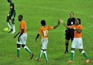 Ivory Coast players Didier Drogba (right), Gervais Yao Kouassi aka Gervinho (centre) and Yaya Toure celebrates their team's goal during the Africa Cup of Nations qualifier against Senegal at the Felix Houphouet-Boigny stadium in Abidjan on September 8, 2012. Ivory Coast will once again be the team to beat when South Africa stages the finals of the 2013 Africa Cup of Nations early next year