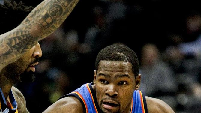 Oklahoma City Thunder's Kevin Durant, right, drives past Denver Nuggets' Wilson Chandler, left, during the third quarter of an NBA basketball game Tuesday, Dec. 17, 2013, in Denver. The Thunder won 105-93