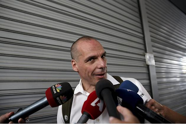 Greek Finance Minister Varoufakis makes statements to the media as he arrives at the ministry in Athens