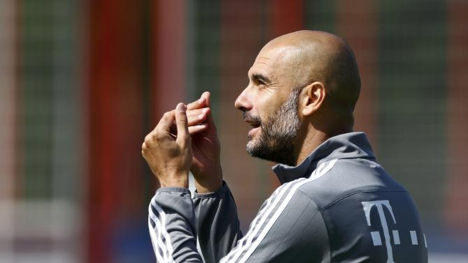 Bayern Munich's head coach Guardiola gestures during a training session in Munich