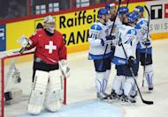 Finnish players celebrate scoring against Switzerland during a preliminary round match of the IIHF International Ice Hockey World Championship in Helsinki. Finland won 5-2