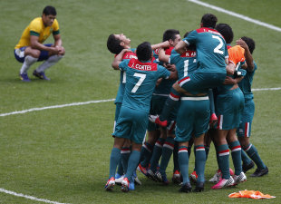 Mexico's players celebrate their victory over Brazil at the men's soccer final gold medal match (REUTERS)