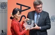 Aung San Suu Kyi receives the Asia Society's Global Vision Award from Tom Freston, trustee, at the United States Institute of Peace in Washington, DC. At the award ceremony, Suu Kyi took pains to reassure China over her trip to the US, which was the junta's main ally