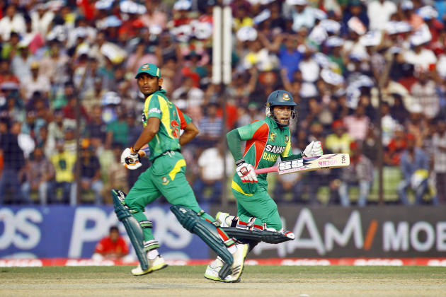 Bangladeshi Mushfiqur Rahim, right, and Anamul Haque run between the wickets during the Asia Cup one-day international cricket tournament against India in Fatullah, near Dhaka, Bangladesh, Wednesday,