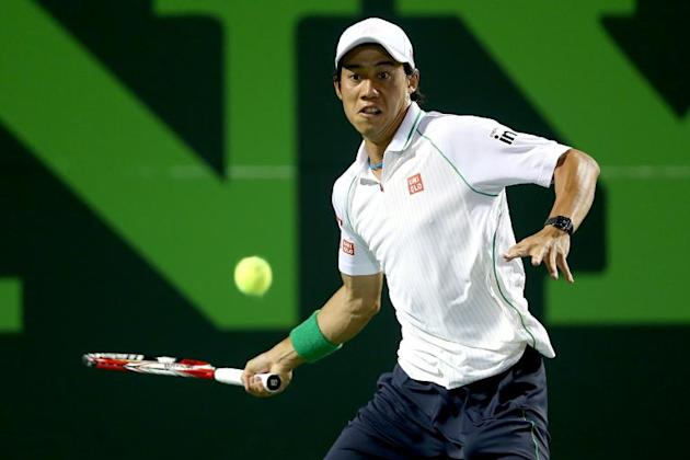 Kei Nishikori of Japan returns a shot to Roger Federer during the Sony Open at the Crandon Park Tennis Center on March 26, 2014 in Key Biscayne, Florida