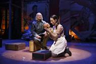 """This theater publicity image released by The Publicity Office shows Christopher Lloyd, left, and Elizabeth A. Davis in a scene from Bertolt Brecht's """"The Caucasian Chalk Circle"""", currently performing off-Broadway at Classic Stage Company in New York. (AP Photo/The Publicity Office; Joan Marcus)"""
