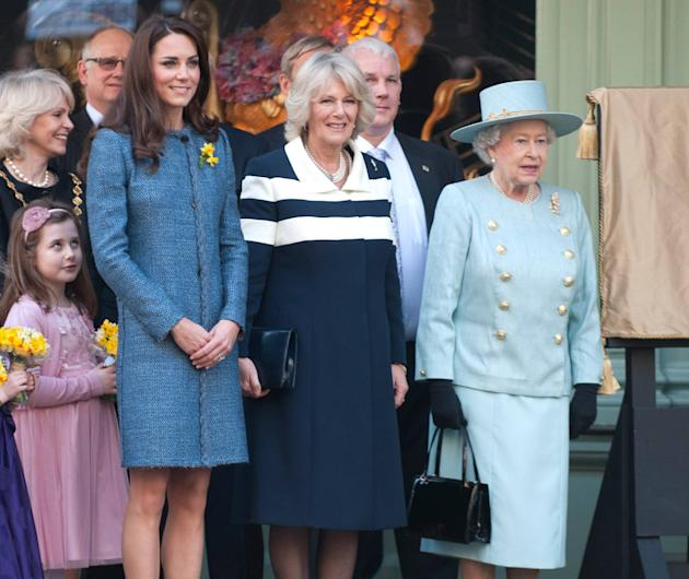 Queen Elizabeth II, Camilla, Duchess of Cornwall and Catherine, Duchess of Cambridge, aka Kate Middleton,  unveiling a plaque at Fortnum & Mason during the Queen's Diamond Jubilee year to commemorate